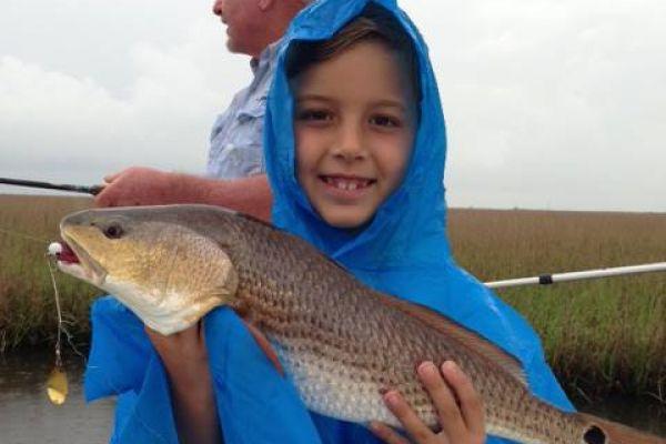 kid-with-redfish73BD32A7-484C-E501-4AD1-F13CE46E18AA.jpg