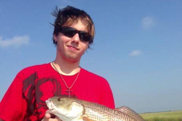 young-guy-redfish16BC14C3-94CA-5FDD-E94D-9D76625D3DB8.jpg